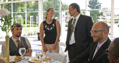 Sarah Cummins talks with men from Wheeler Mission, at the Ritz Charles, Saturday, July 15, 2017. Cummins called off her wedding which was supposed to be this day. She decided to bring purpose to her pain by inviting area homeless to enjoy the reception. (Kelly Wilkinson/The Indianapolis Star via AP)