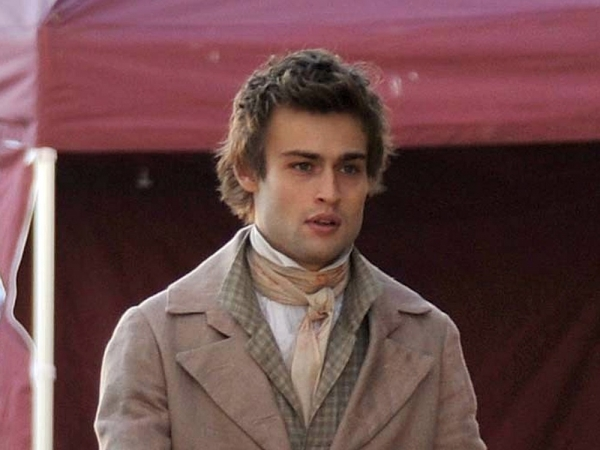 Douglas Booth as Shelley. As an aside, Shelley was famous for wearing his shirts open at the neck. The movie could not even get this right.