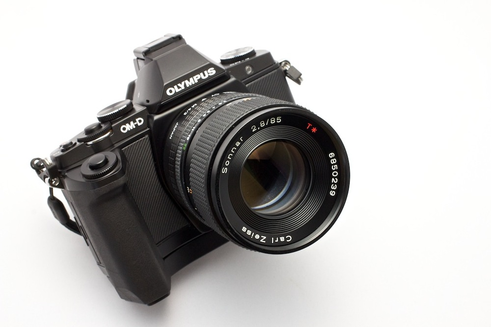 Zeiss 85mm f/2.8 Sonnar on an Olympus OM-D. Effective focal length is 170mm at f/2.8.