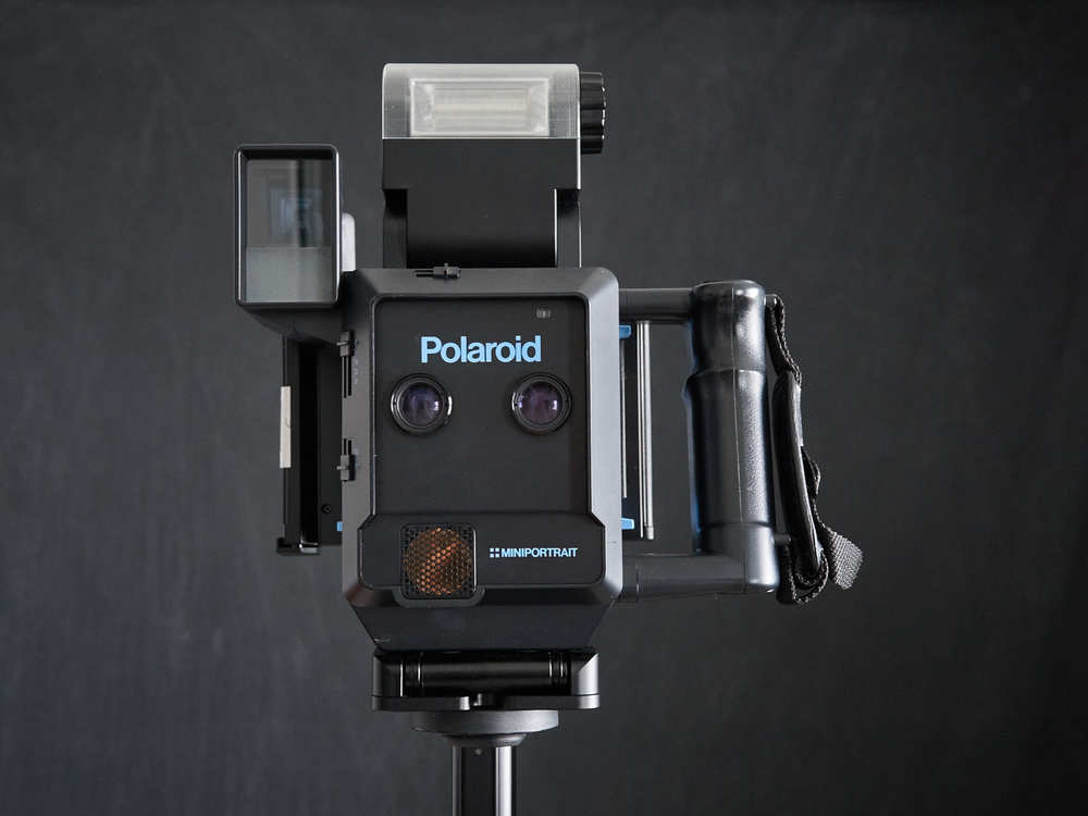 The Polaroid MiniPortrait 203 front view showing twin lenses. Photo by Derrick Story.