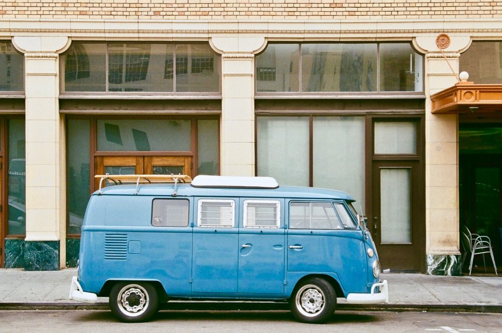 """Blue VW Bus, Oakland"" - Captured with a Pentax ZX-5n and Pentax-F 35-70mm zoom on Kodak 400 film. Photo by Derrick Story."