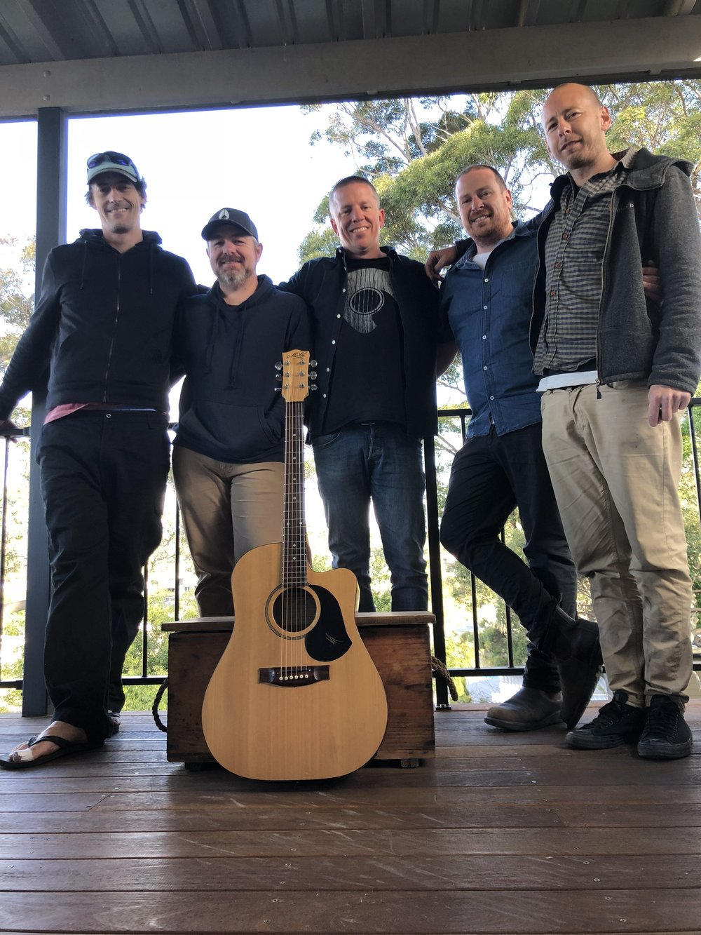 Andrew Carty, Simon Hill, Stephen Askew, Adam Schilli, Ben Russell with the guitar representing the late Simon Lambert.jpeg