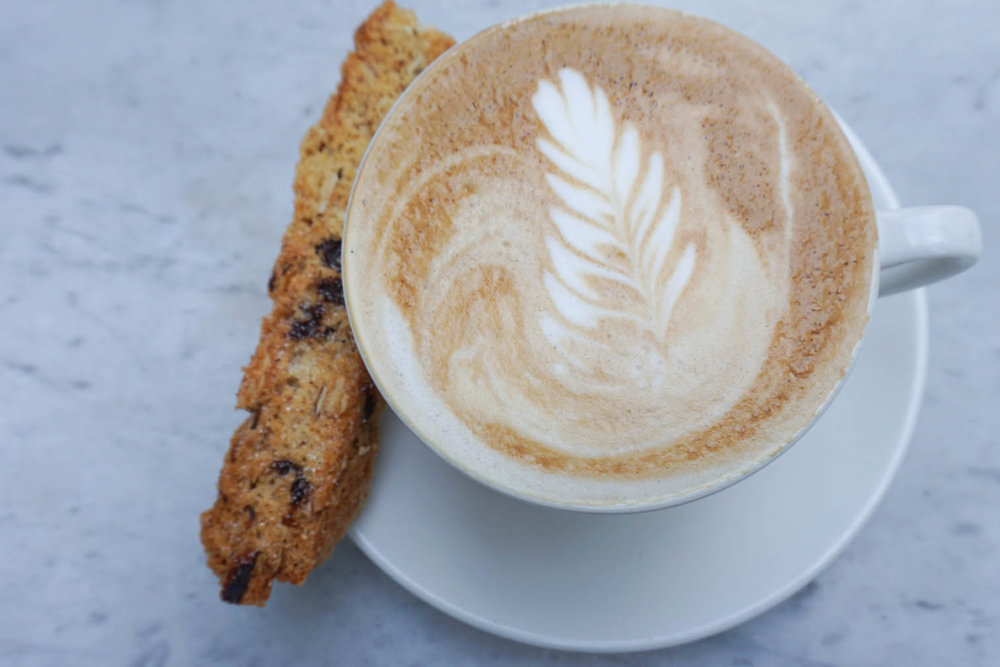 vanilla latte and biscotti at dineen coffee in toronto