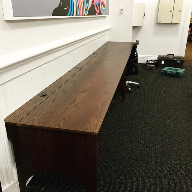 Oak desk for MBM, has a channel at the back with powerpoints in it and nice lids to cover them.