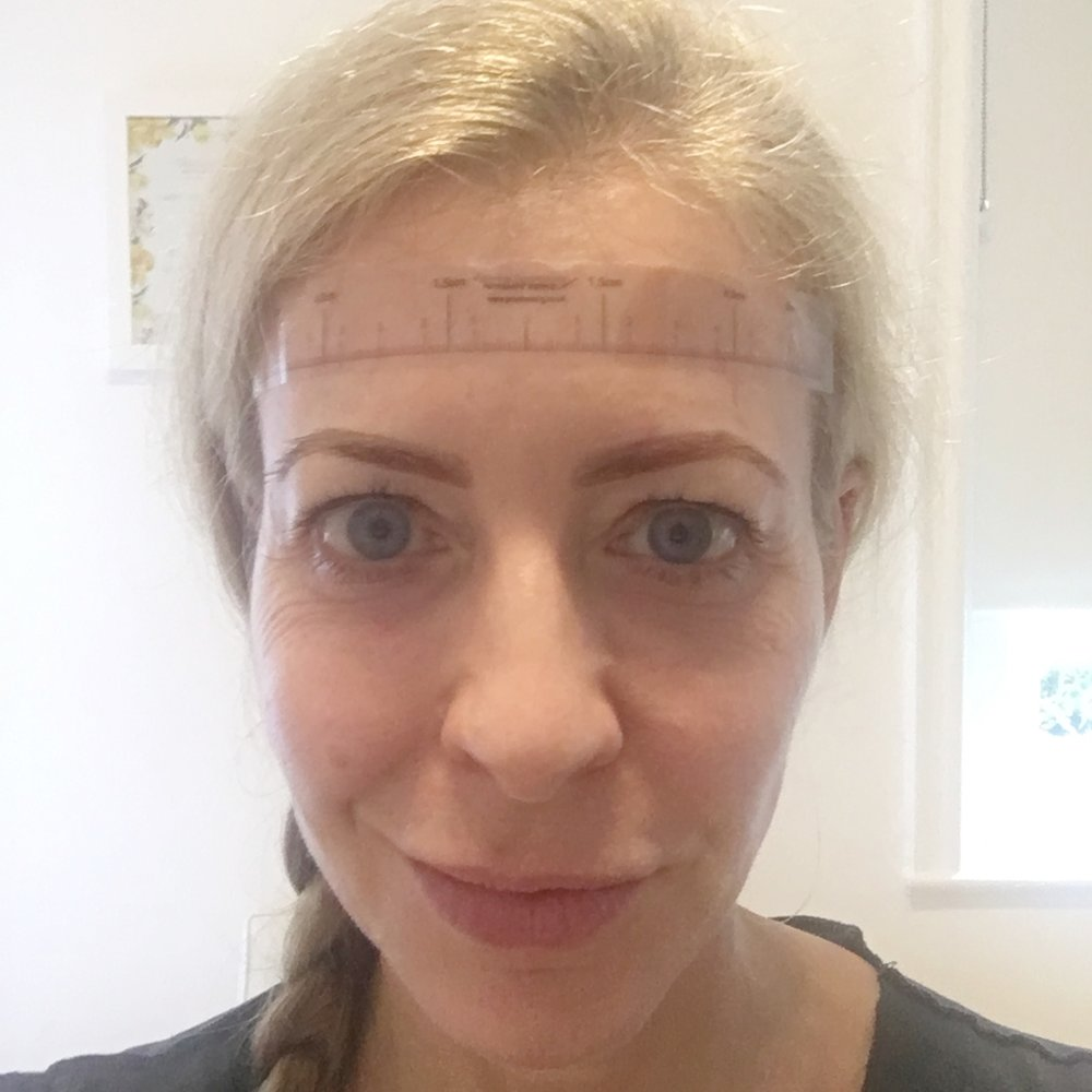Eyebrows drawn on with brow pencil - this is the guideline Sian will follow
