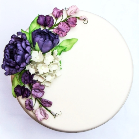 "12"" iced fruit cake with peony, sweet pea and hydrangea sugar flower detail."