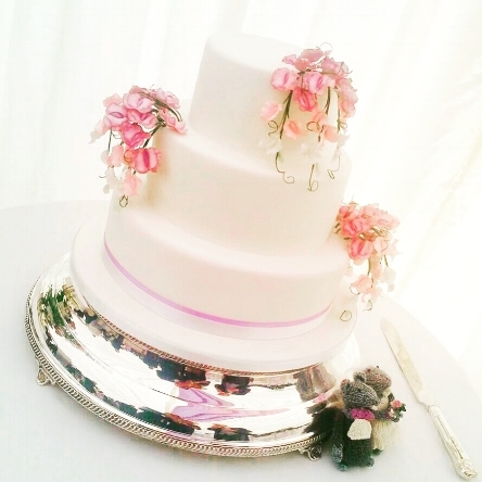 3 tier wedding cake with sweet pea design.