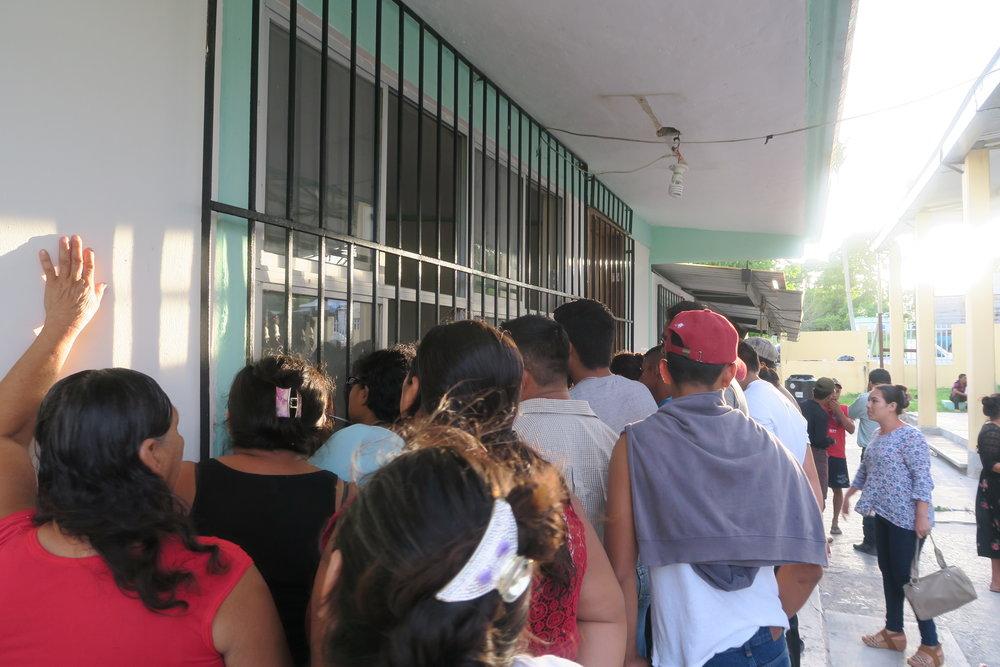 crowds monitoring the voting underway