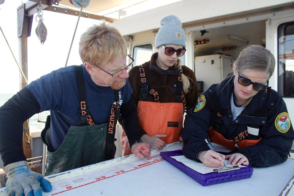 SCDNR crustacean staff Jeff Brunson, Kristin Linesch, and Elizabeth Gooding run through the shrimp-tagging and data collection process before pulling in the trawl net. (Photo: E. Weeks/SCDNR)