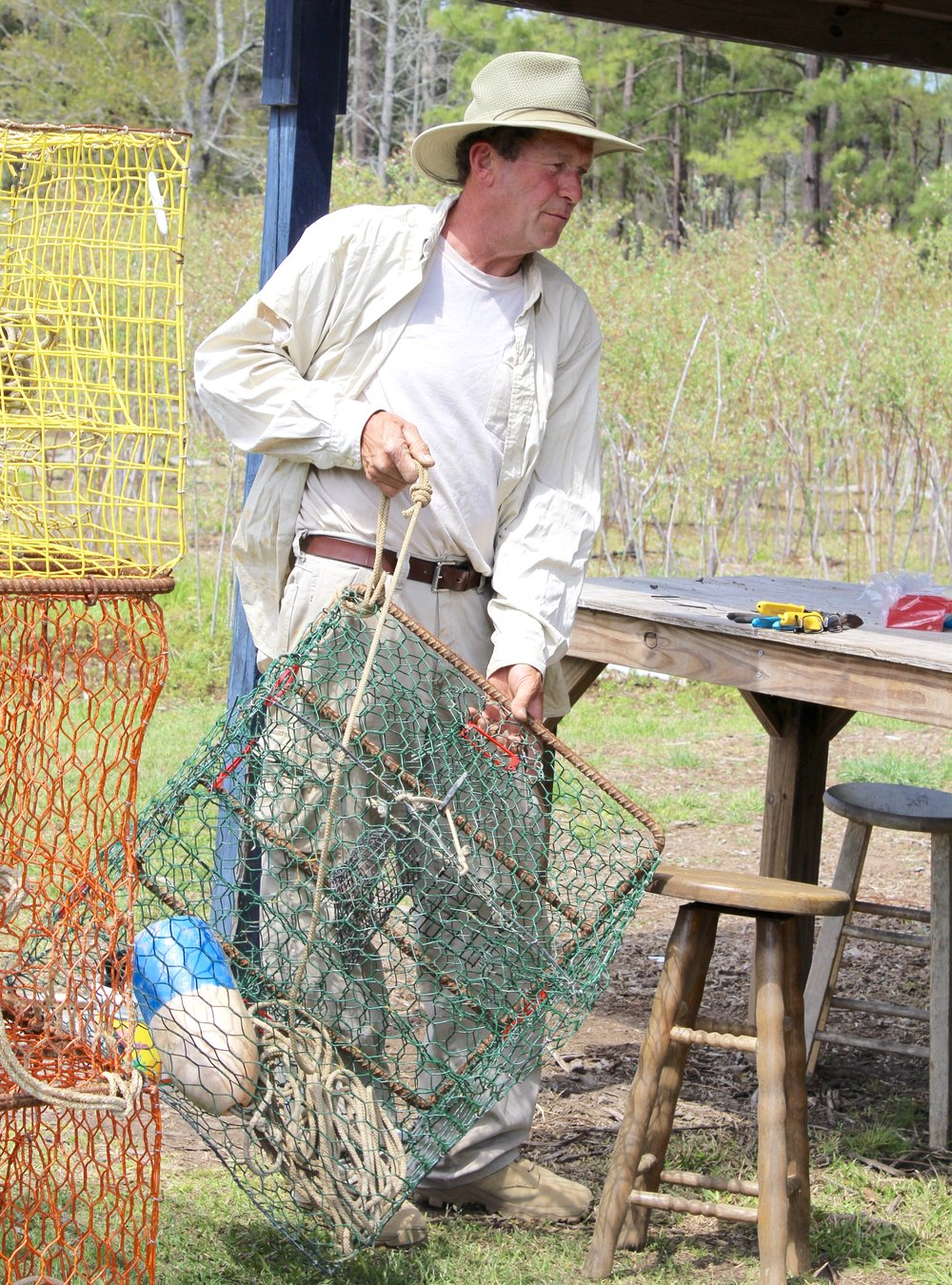 Crabber Robert Sollot finishes installing four bycatch reduction devices (BRDs) on one of his 120 crab traps. (Photo: E. Weeks/SCDNR)