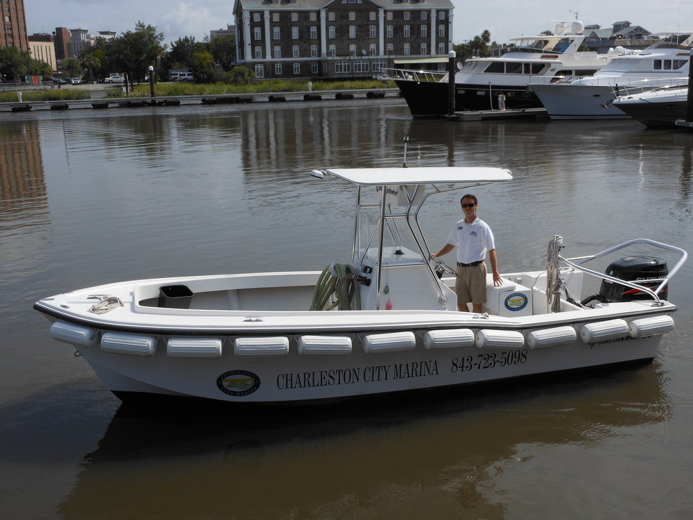 A Charleston City Marina staffer mans the Bow Movement, one of three pumpout boats at the marina where other vessels can discharge their sewage. (Photo: Scott Meister/SCDNR)