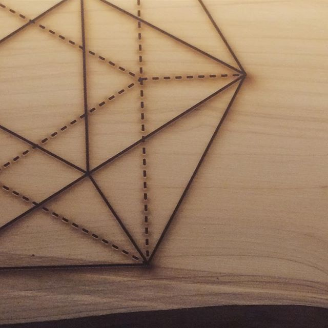 Today on the laser bed: icosahedron on live-edge cedar. #wip #laseretched #cedarwood #woodworking #platonicsolids #geometry