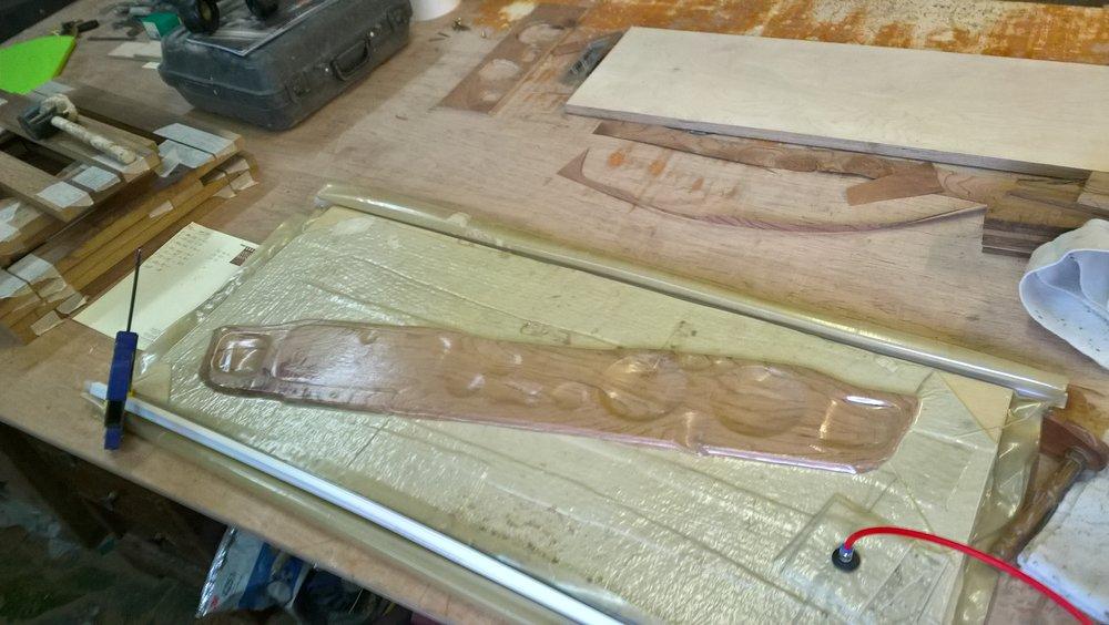 The Elm veneer is being glued to the dashboard via a vacuum press.