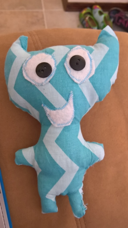 The blue one is prototype #1, he has some problems, namely the stitches around the eyes and mouth. I don't have the right presser foot to apply appliques, so I was trying to eyeball it and that didn't go well at all. I have decided to sew those on by hand from now on.