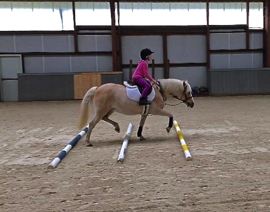 girl riding indoor.jpg