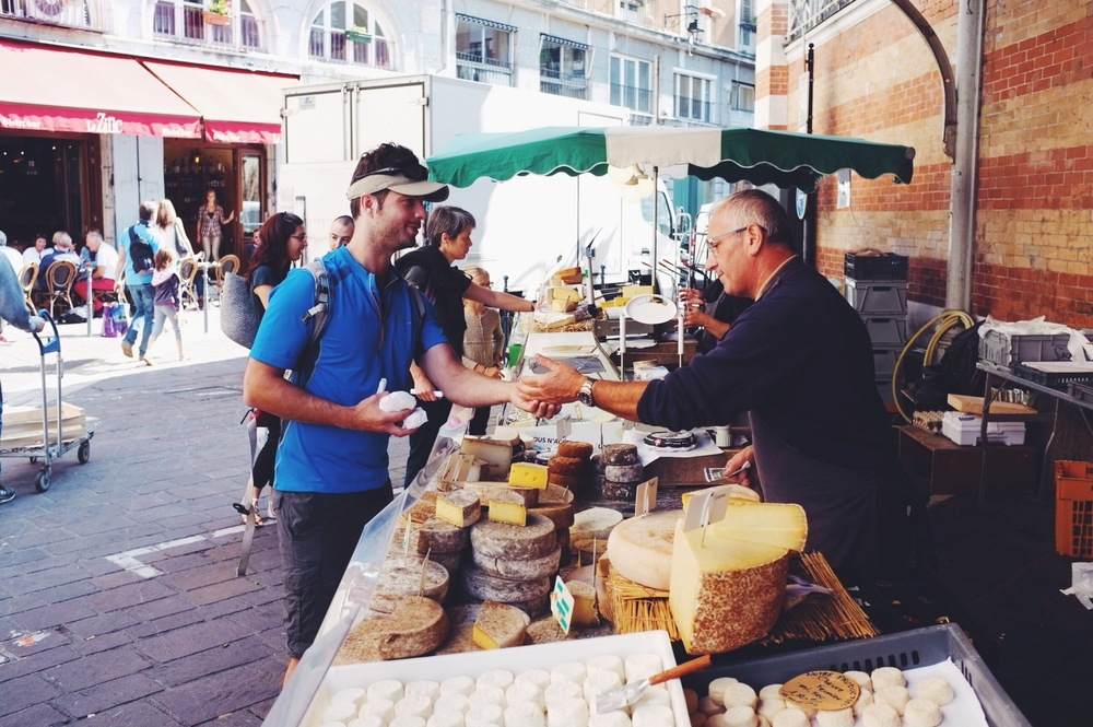 Gotta love the French cheese. Rob buying the goods before our big hike yesterday.