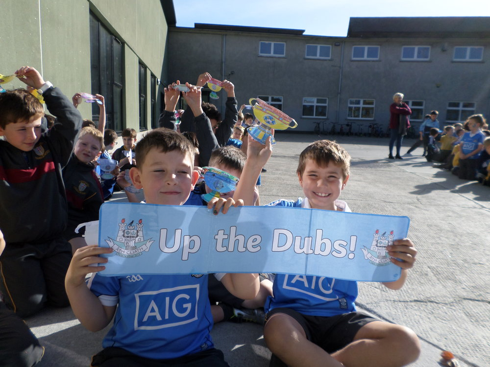 Up the Dubs! - The boys were over the moon when the Sam Maguire cup came to visit the school! We had made banners and trophies of our own and were so excited to meet Brian Fenton and Brian Howard.Tom and A.J. had the opportunity to interview the players and asked them about their scoring records in last year's championship.We took photos with the players and the cup and Brian Fenton gave us a night off homework!