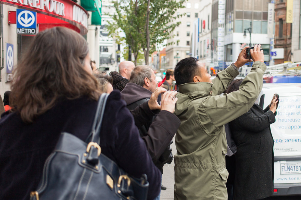 MONTREAL, QUEBEC – OCTOBER 19 2018 : The long lineup outside the Société Québécoise du Cannabis outlet on Ste-Catherine street on opening today attracted a crowd of viewers, photographing the historic event with their cell phones on October 17th, 2018 in Montreal, Quebec. (Photo by Matteo Gueli /Dawson College Photojournalism Class)