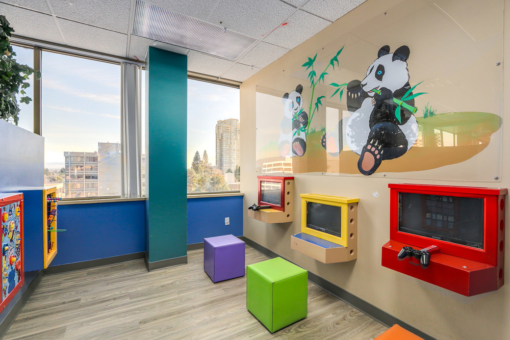 Burnaby's Play Area has wall-mounted toys, books, iPad games & a Treasure Tower for kids after their visit.