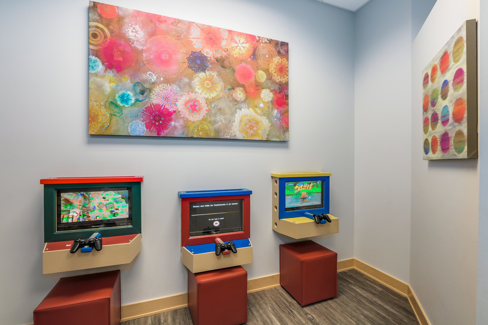 Surrey's Play Area has wall-mounted toys, books, Sony Playstation games & a Treasure Tower for kids after their visit.