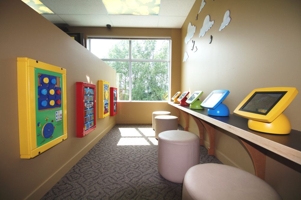 Port Moody's Play Area has wall-mounted toys, books, iPad games & a Treasure Tower for kids after their visit.