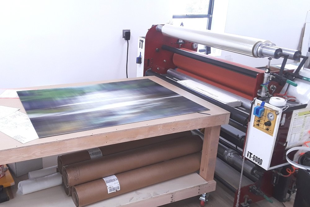 "Our press is capable of mounting photographs up to 60"" x 120"""