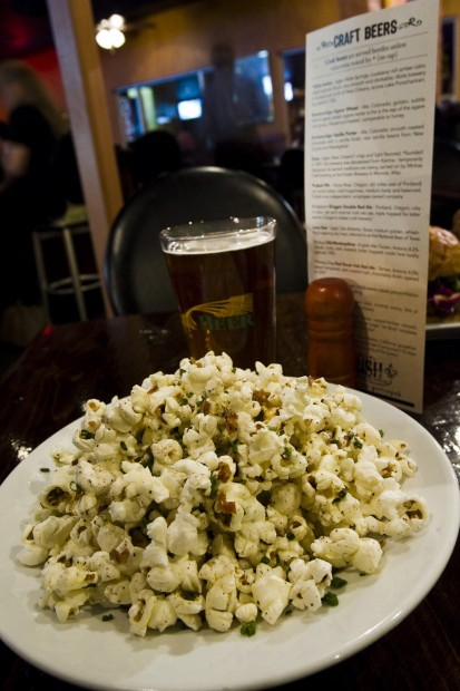 Ron Medvescek / Arizona Daily Star The Parish's popular bacon popcorn is made by cooking popcorn in bacon grease along with bacon. The kernels are finished with butter and chives.