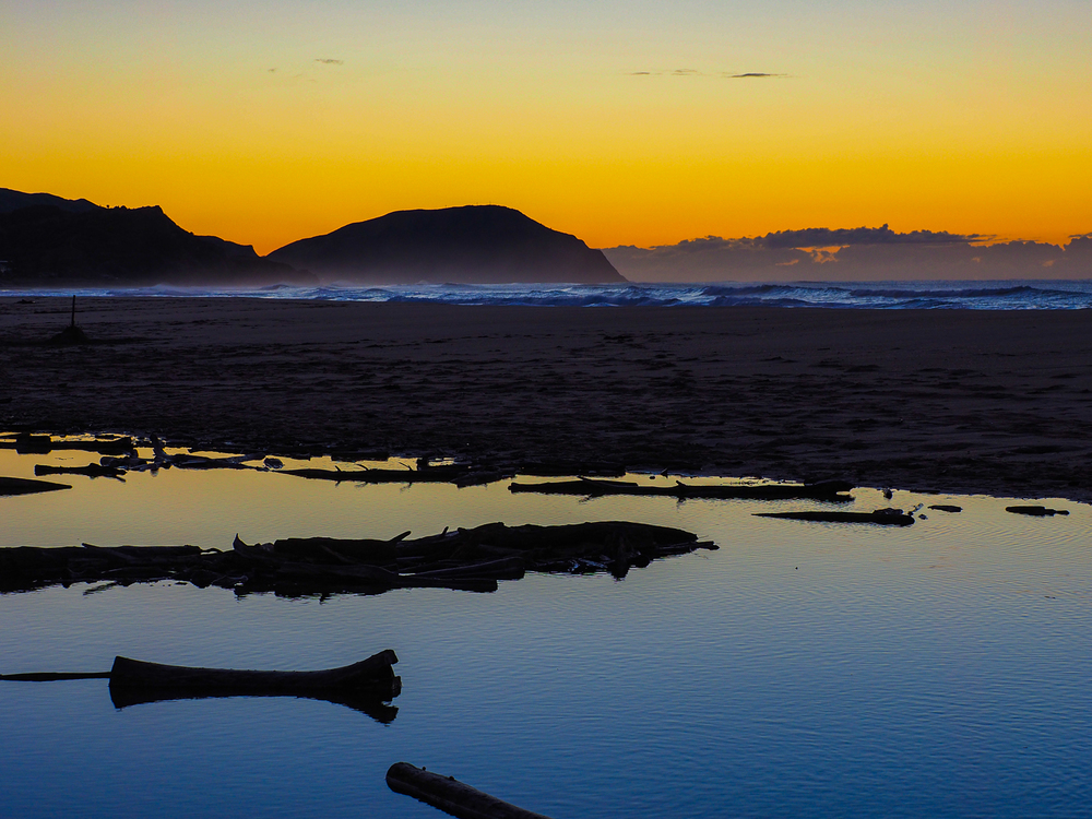 Winter dawn. Wainui Beach.