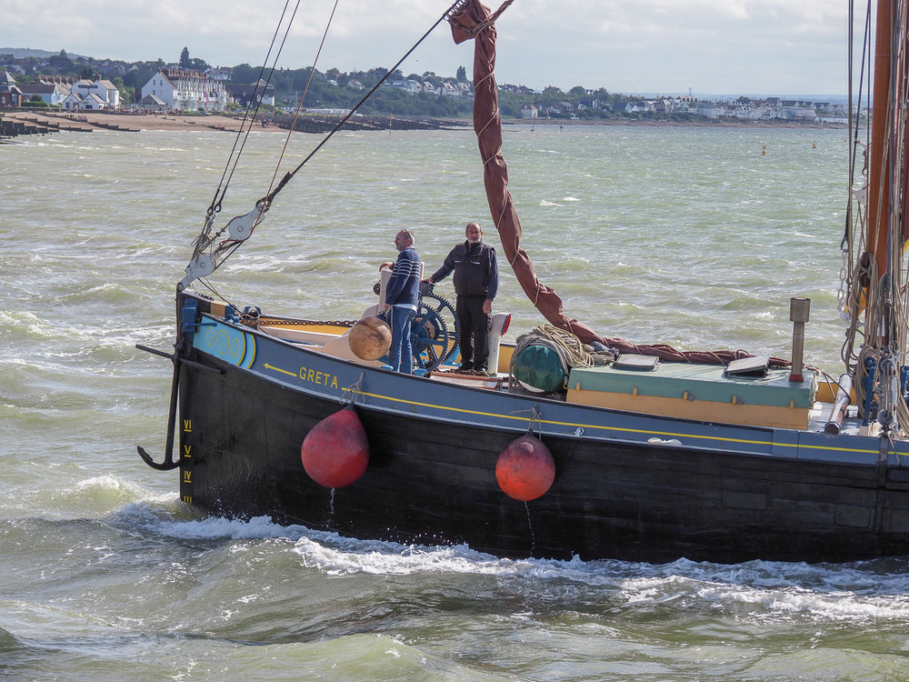 Whitstable Harbour bound 'Greta', a historic Thames sailing barge built in 1892 to transport cargo on the River Thames.