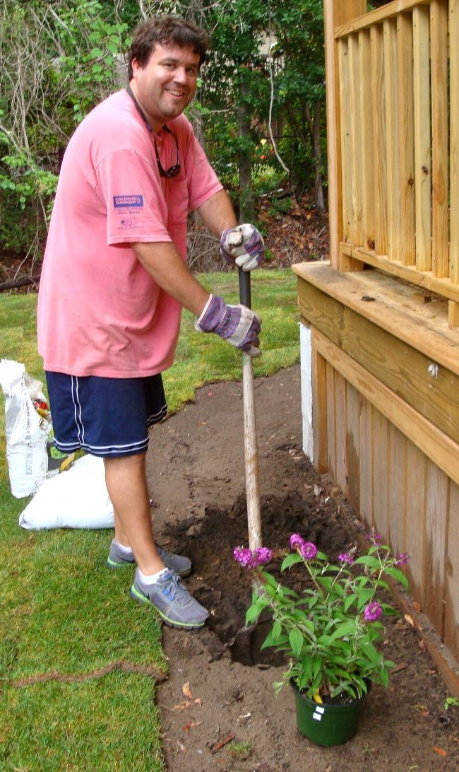 Scott Toole planting flowers.