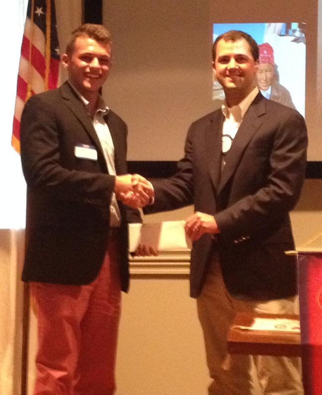 Ethan Courville 2014 Scholarship Runner-Up receives a check for $1000