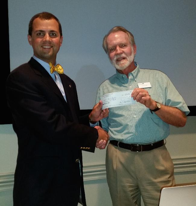 Chris Brooks receives a check for East Cooper Meals on Wheels (2015).