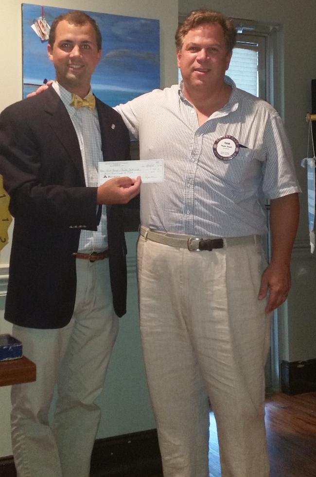 Thom Gault receives a check for ECFN (East Cooper Faith Network). 2015