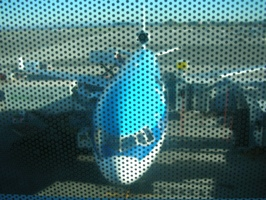 The Plane to Amsterdam, through a windowshade