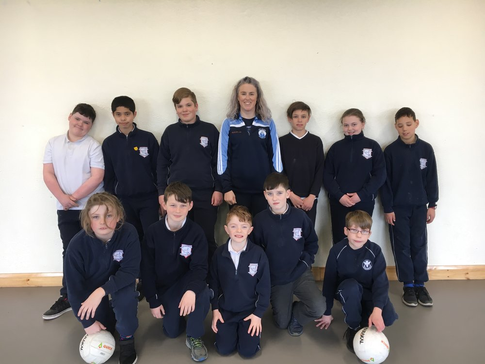 We have been very lucky to Therese O'Keeffe, from  Brian Dillons GAA  club in Mayfield, coach us each Friday in GAA skills. Therese has been terrific with all the children - even remembering every name!   Everyone is really enjoying these sessions.