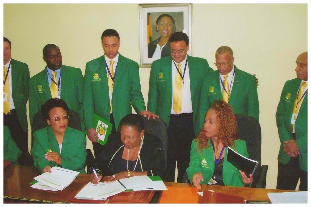 JOIHF Delegation Team signing w Minister Olivia Grange.jpg