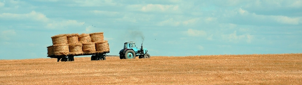 Rancher moves straw bails off of Montana ranch