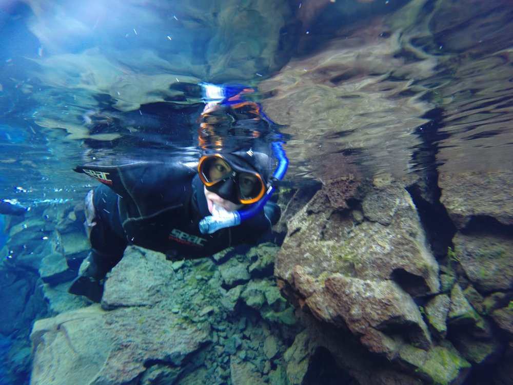 Snorkeling in the Silfra fissure, in Iceland, a rift between the North American and Eurasian tectonic plates. At Silfra, you are literally swimming in between two continents!!!