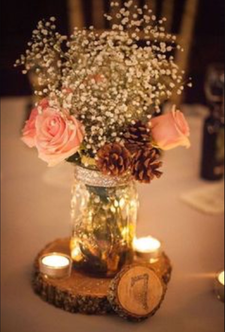 Peach roses with baby breath in glass jars