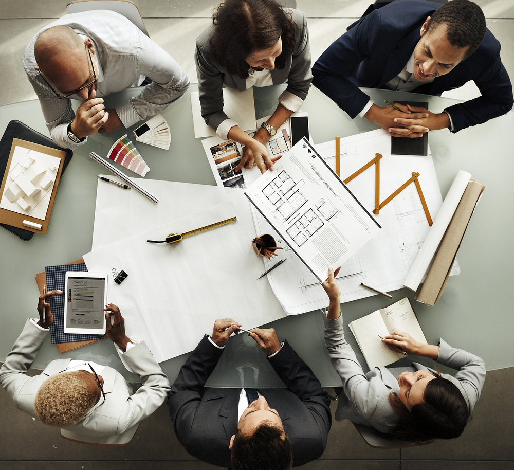 business-people-meeting-architecture-blueprint-P8T5QWK.jpg