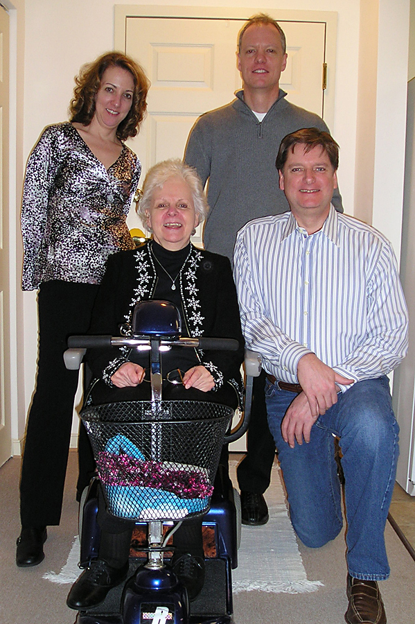 Diane and her three children in the entrance to her apartment just a few years ago