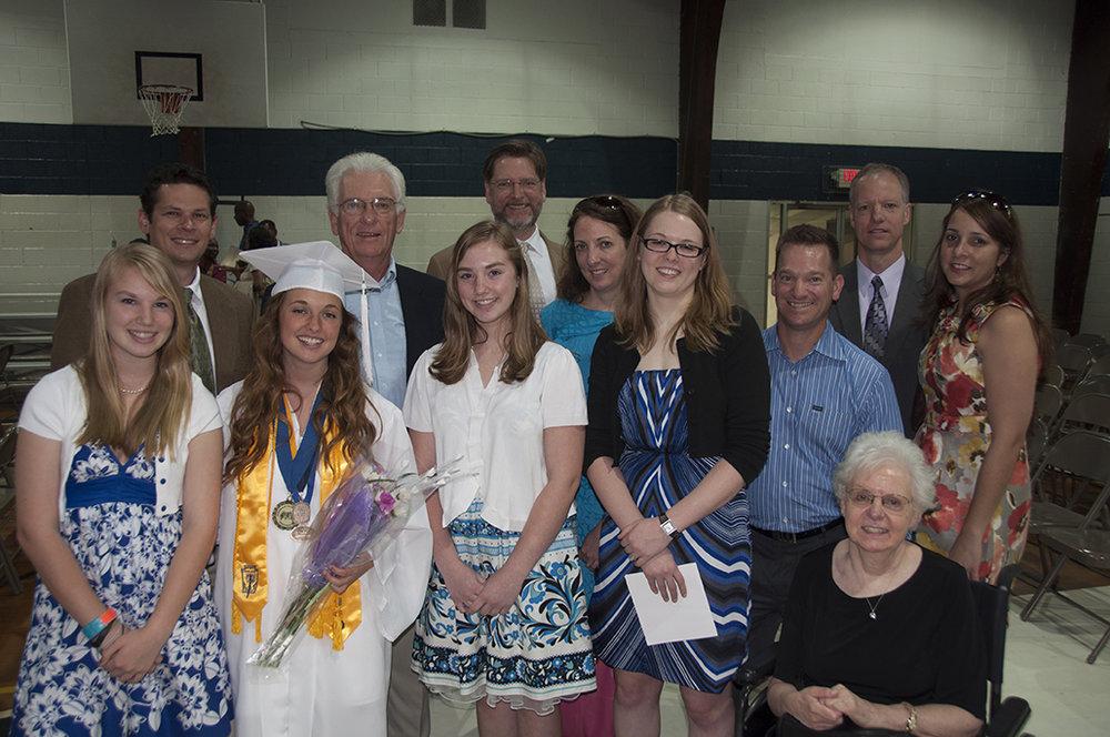 The clan at Madison's high school graduation