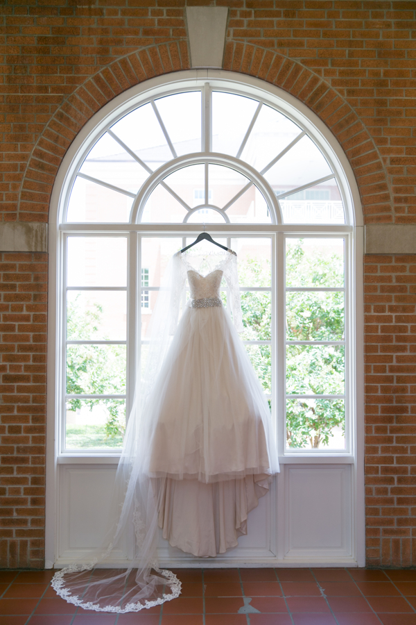 wedding-dress-hanging-in-church-window