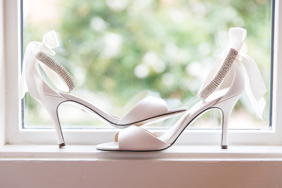 brides-shoes-in-church-window