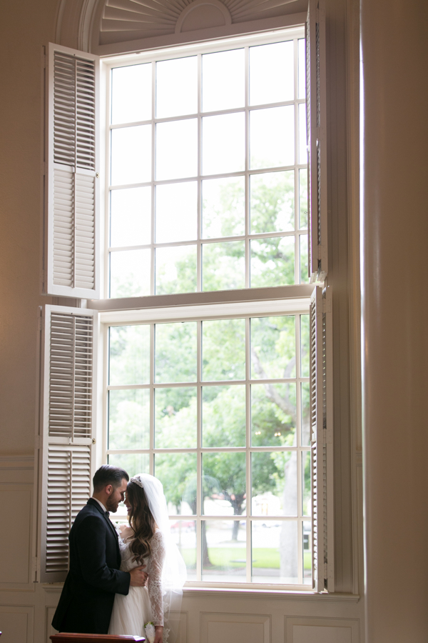 bride-and-groom-by-window