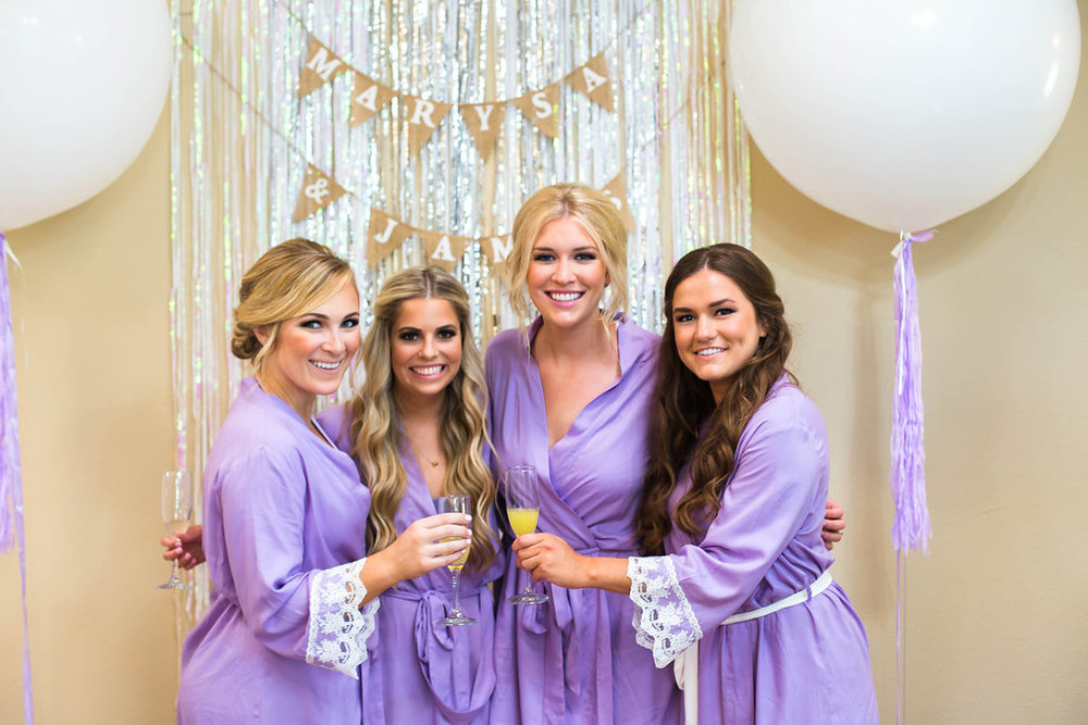 bridesmaid-toast-with-champagne