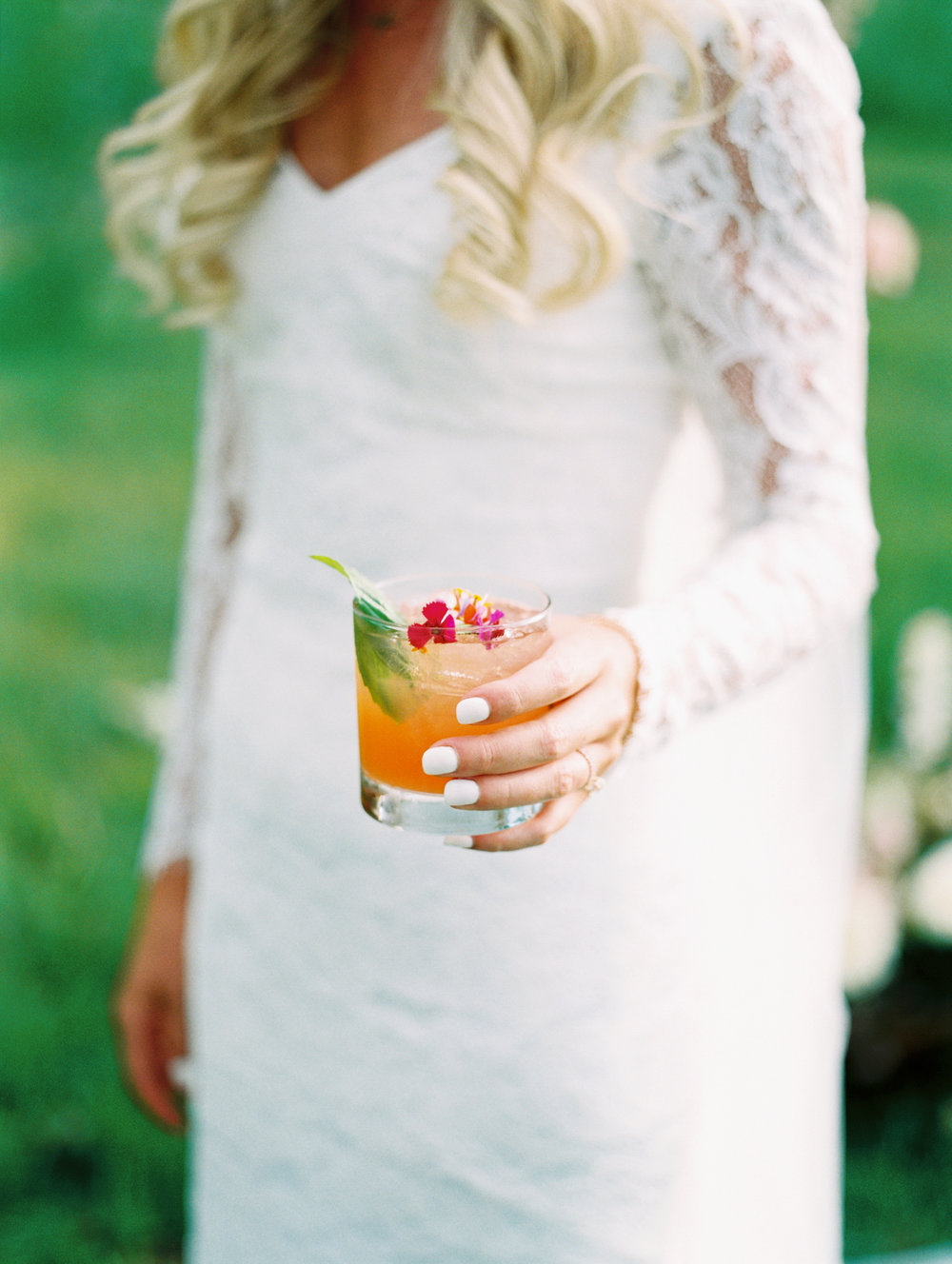 bride-holds-drink-steamboat-springs-colorado.JPG
