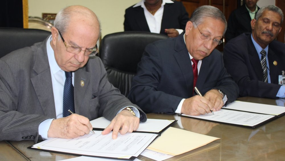 """President of the University of Panama Dr. Gustavo Garcia De Paredes (left) together to President of the Adventist Church in East Panama Pastor Jose De Gracia sign special agreement on May 15, 2014, at the campus of the University of Panama in Panama City, Panama. Both entities will join efforts in developing initiatives to counter the growing violence affecting the most vulnerable sectors in the Central American country. Image courtesy of East Panama Conference/IAD http://www.interamerica.org/?p=12222#axzz36EkE4Akj"