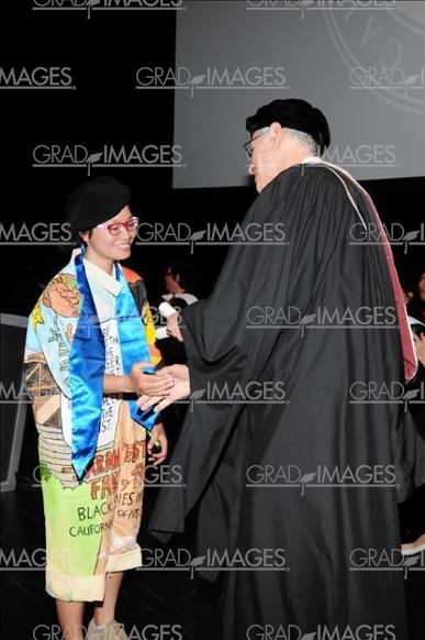 The Jumpsuit receiving diploma