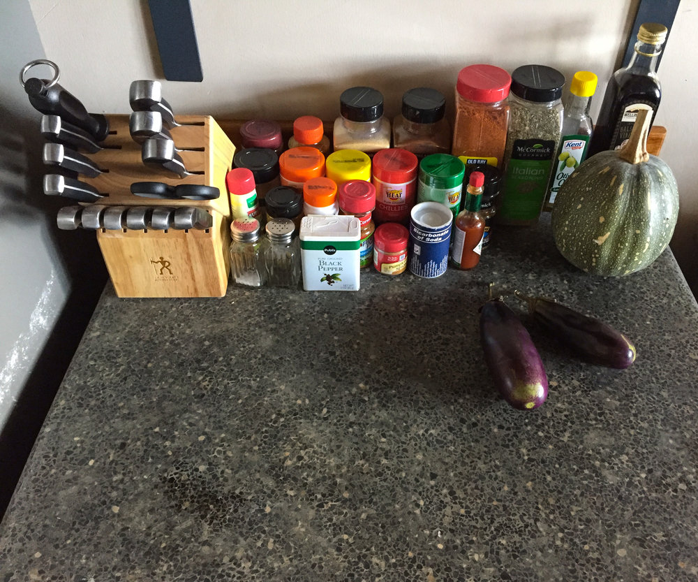"My ""prepping"" area also doubles as the home for my spices – a collection that seems to grow daily. While the space is not big, I love the concrete countertop."